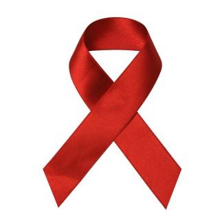 Eine Rote Schleife als Symbol der Solidarität mit HIV-Infizierten und AIDS-Kranken.