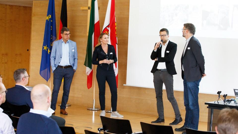 Organisatoren der Veranstaltung: Eine Frau und drei Männer